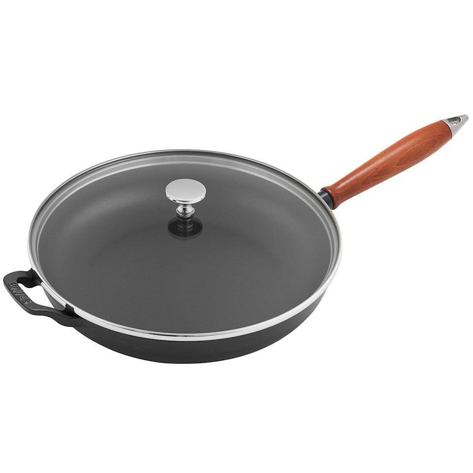 "<p><strong>Staub</strong></p><p>surlatable.com</p><p><a href=""https://go.redirectingat.com?id=74968X1596630&url=https%3A%2F%2Fwww.surlatable.com%2Fstaub-vintage-11-skillet-with-lid%2FPRO-6053508.html&sref=https%3A%2F%2Fwww.goodhousekeeping.com%2Flife%2Fmoney%2Fg34145489%2Fsur-la-table-anniversary-sale-2020%2F"" rel=""nofollow noopener"" target=""_blank"" data-ylk=""slk:Shop Now"" class=""link rapid-noclick-resp"">Shop Now</a></p><p><strong><del>$300</del> $176.96 (44% off)</strong></p><p>From scrambling eggs, to sautéing veggies, to making an ooey, gooey quesadilla, a skillet can be one of the most versatile pieces in your entire kitchen. Thanks to Sur La Table's sale, you can save $125 on Staub's popular skillet.</p>"