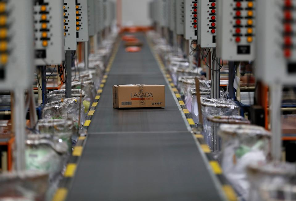A package for delivery is seen on a conveyor belt at online retailer Lazada's warehouse in Depok, south of Jakarta, Indonesia March 26, 2018. Picture taken March 26, 2018. REUTERS/Darren Whiteside