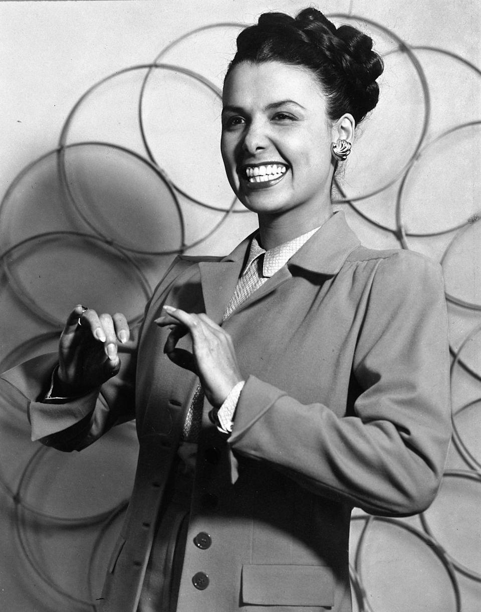 <p>Lena Horne wears a tailored jacket over a sleek button-down.</p>