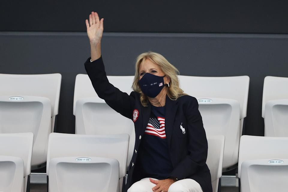 Biden wears the Ralph Lauren navy jacket and trousers that are part of the official US Olympic Team uniform to the Tokyo Aquatics Centre (Getty Images)