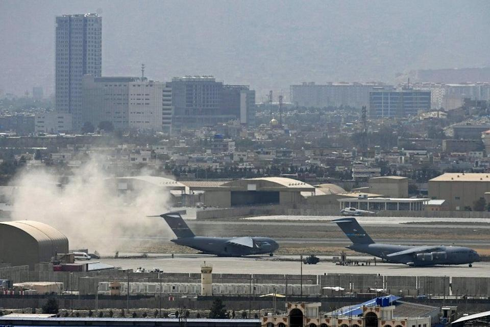 A US air force plane prepares for take-off from Kabul airport on Monday  (AFP/Getty)