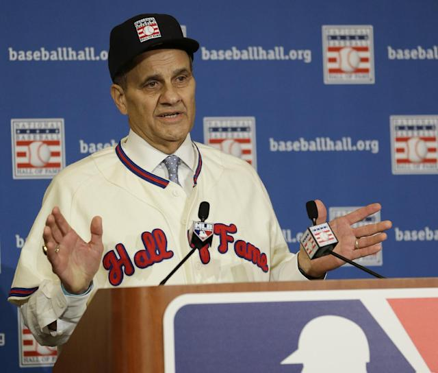 Joe Torre speaks at a news conference after it was announced that he, Tony La Russa, and Bobby Cox were unanimously elected to the baseball Hall of Fame at the MLB winter meetings in Lake Buena Vista, Fla., Monday, Dec. 9, 2013. Torre and Cox retired as managers after the 2010 season and La Russa after leading St. Louis to the 2011 championship. Torre won four World Series titles with the Yankees, La Russa three with Oakland and the Cardinals, and Cox one with Atlanta. (AP Photo/John Raoux)
