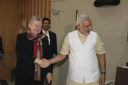 U.S. ambassador to India Nancy Powell (L) shakes hands with Hindu nationalist Narendra Modi (R), prime ministerial candidate for India's main opposition Bharatiya Janata Party (BJP) and Gujarat's chief minister, during their meeting in Gandhinagar in the western Indian state of Gujarat February 13, 2014. REUTERS/Gujarat Information Department/Handout via Reuters