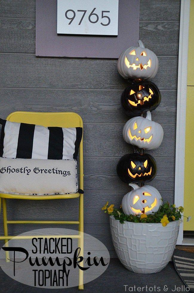 """<p>Stack black and white Jack-o-Lanterns for an eye-catching twist day and night.</p><p><strong>Get the tutorial at <a href=""""http://tatertotsandjello.com/2014/10/easy-black-white-halloween-topiary-lowescreator.html"""" rel=""""nofollow noopener"""" target=""""_blank"""" data-ylk=""""slk:Tatertots & Jello"""" class=""""link rapid-noclick-resp"""">Tatertots & Jello</a>.</strong> </p>"""