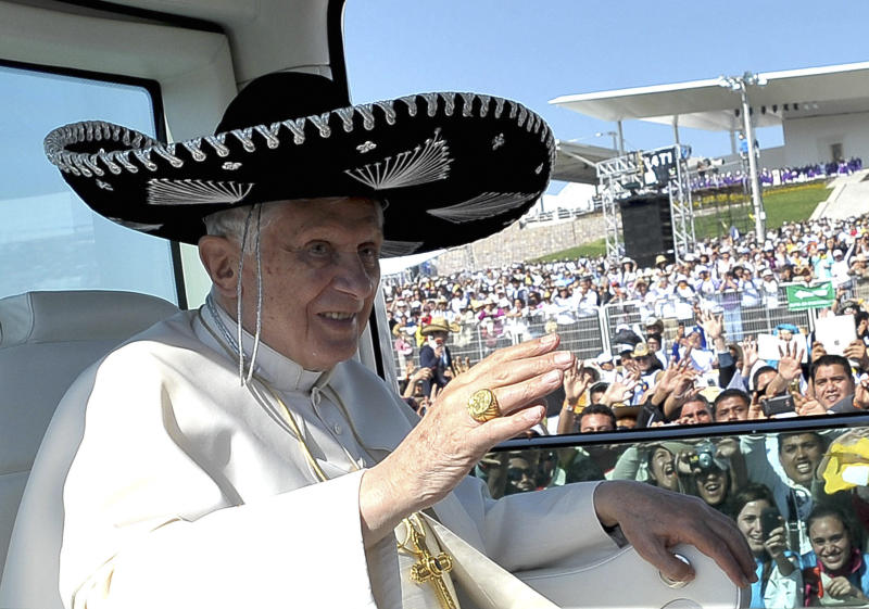 """FILE -- In this file photo taken on March 25, 2012, Pope Benedict XVI waves from the popemobile wearing a Mexican sombrero as he arrives to give a Mass in Bicentennial Park near Silao, Mexico. Turin's La Stampa newspaper reported Thursday, Feb. 14, 2014, that Benedict hit his head and bled when he got up in the middle of the night in an unfamiliar bedroom in Leon, Mexico. The report said blood stained his hair, pillow and floor. Vatican spokesman the Rev. Federico Lombardi confirmed the incident but said """"it was not relevant for the trip, in that it didn't affect it, nor in the decision"""" to resign. (AP Photo/Osservatore Romano)"""