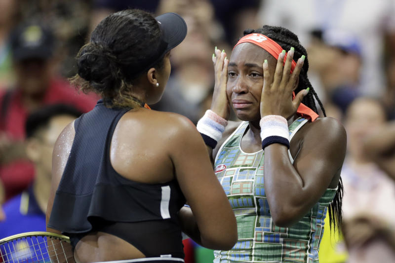 Coco Gauff wipes away tears while talking to Naomi Osaka, of Japan, after Osaka defeated Gauff during the third round of the U.S. Open tennis tournament Saturday, Aug. 31, 2019, in New York. (AP Photo/Adam Hunger)