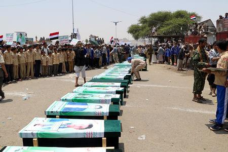 FILE PHOTO: Mourners attend a funeral of people, mainly children, killed in a Saudi-led coalition air strike on a bus in northern Yemen, in Saada