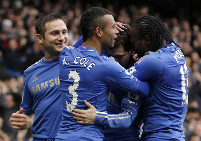 Chelsea's Eden Hazard, second right, celebrates his goal against West Ham United with teammates during their English Premier League soccer match at Stamford Bridge, London, Sunday, March 17, 2013. (AP Photo/Sang Tan)