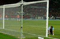 Uruguay's Jose Maria Gimenez reacts after Chile's Mauricio Isla, unseen, scored a goal during a Copa America quarterfinal soccer match at the National Stadium in Santiago, Chile, Wednesday June 24, 2015. (AP Photo/Luis Hidalgo)