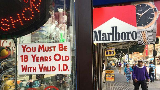 PHOTO: A sign posted outdoors at a smoke shop reads 'You Must Be 18 Years Old with Valid I.D.,' in downtown Los Angeles on Wednesday, June 8, 2016. (Damian Dovarganes/AP Photo)