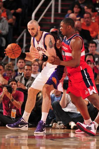 PHOENIX, AZ - FEBRUARY 20: Marcin Gortat #4 of the Phoenix Suns is guarded by Kevin Seraphin #13 of the Washington Wizards in an NBA game played on February 20, 2012 at U.S. Airways Center in Phoenix, Arizona. (Photo by Barry Gossage/NBAE via Getty Images)
