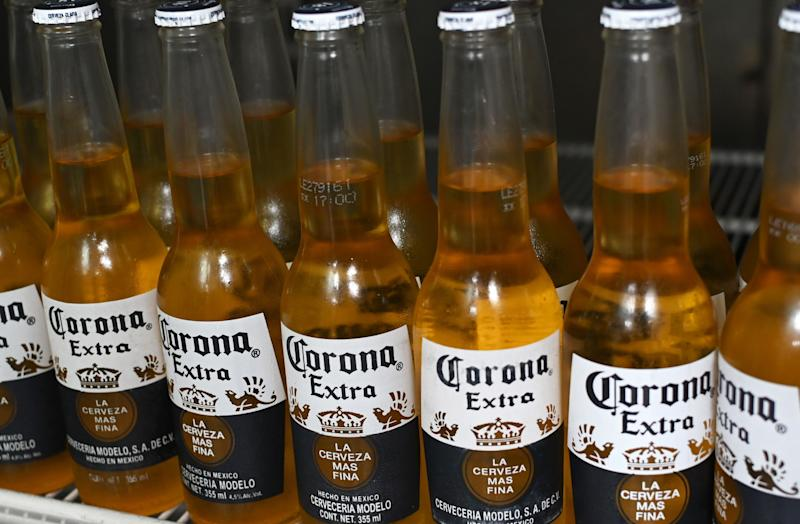 Picture of bottles of Mexican beer Corona, taken in Mexico City on June 4, 2019. - Donald Trump faced fierce opposition Tuesday from his own Republican camp to his threat of tariffs to force Mexico to stem illegal immigration, with top allies warning Congress may not back the US president in his latest trade standoff. Trump has vowed that five-percent tariffs on all imports from its southern neighbor would begin June 10, reaching 25 percent unless Mexico dramatically reduces the flow of undocumented migrants, mainly from Central America, to the US border. (Photo by Rodrigo ARANGUA / AFP) (Photo credit should read RODRIGO ARANGUA/AFP via Getty Images)
