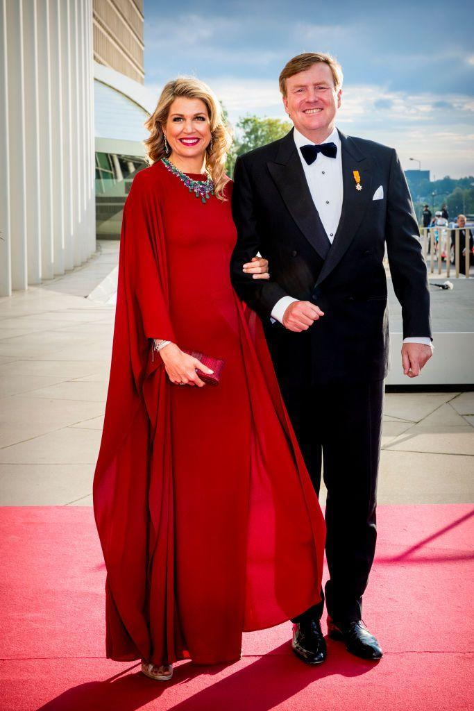 <p>If you're going to wear a cape dress, it seems like a scarlet hue is the way to go. Queen Maxima of the Netherlands wore this flowing gown to attend a 2018 concert in Luxembourg with her husband, King Willem-Alexander. <br></p>