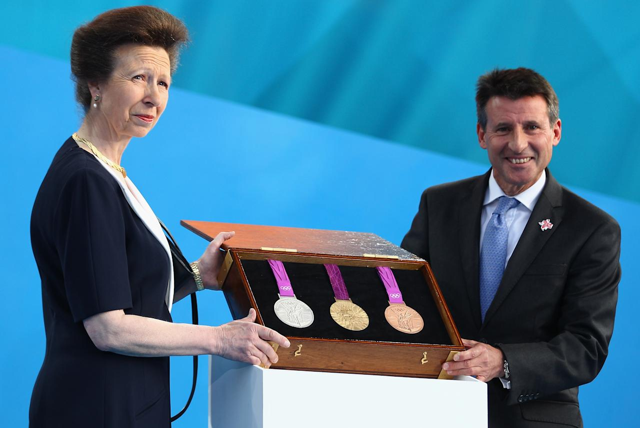 LONDON, ENGLAND - JULY 27:  Princess Anne, Princess Royal and LOCOG Chairman Sebastian Coe present the Olympic medals during  the' London 2012 - One Year To Go' ceremony in Trafalgar Square on July 27, 2011 in London, England. The one year countdown to the London 2012 Olympic games was marked with a unique ceremony in Trafalgar Square, with IOC President Jacques Rogge inviting the world's athletes to compete in next summer's games.  (Photo by Clive Mason/Getty Images)