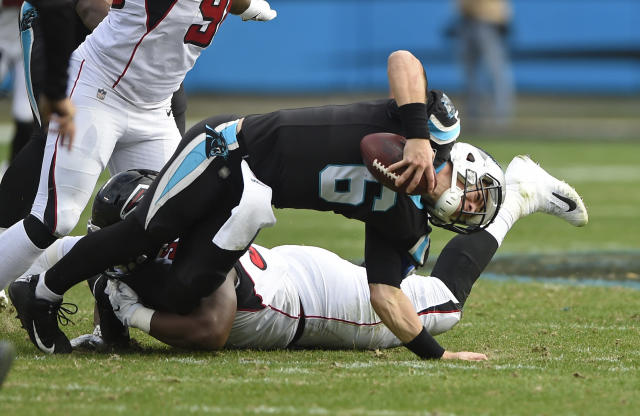 Carolina Panthers' Taylor Heinicke (6) is sacked by Atlanta Falcons' Grady Jarrett (97) during the first half of an NFL football game in Charlotte, N.C., Sunday, Dec. 23, 2018. Heinicke was injured on the play. (AP Photo/Mike McCarn)