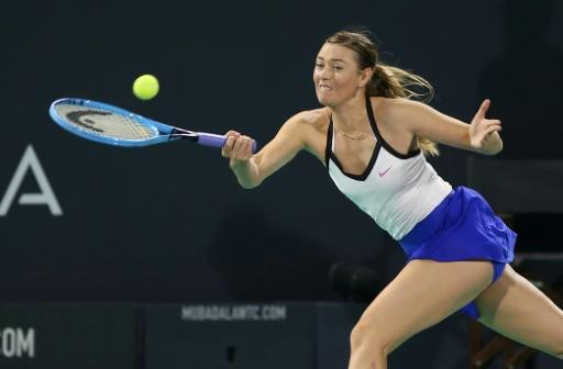 'Fire and motivation': Maria Sharapova returns the ball to Ajla Tomljanovic of Australia