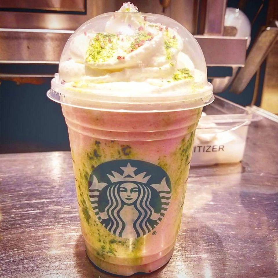 <p>Inspired by Japan's sakura trees, the Cherry Blossom Frappuccino brings together strawberries and cream, along with white chocolate sauce and matcha drizzle. It's topped with whipped cream and a sprinkle of matcha. It's basically spring in a cup!</p>