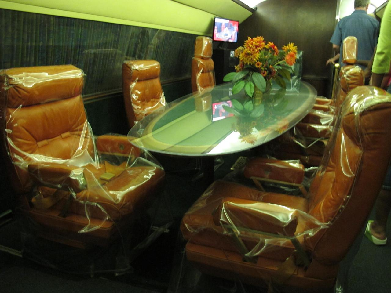 This photo taken on Tuesday, July 1, 2014, shows a large conference table inside the Lisa Marie, one of two jets once owned by late singer Elvis Presley, that are used as tourist exhibits at the Graceland attraction in Memphis, Tenn. The company that operates the Graceland tourist attraction has told the current owners of the Lisa Marie, and another plane called the Hound Dog II, that it wants the planes removed from Graceland by late April 2015, or shortly afterward. (AP Photo/Adrian Sainz)