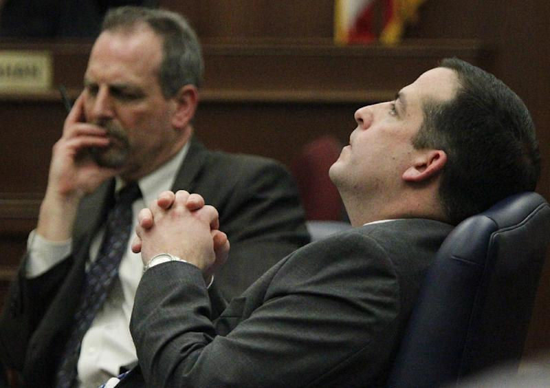 Prosecutors Jon Baumoel, left, and Paul Scarsella listen intensely to the closing defense statements, during the trial of accused CraigsList murderer Richard J. Beasley in Summit County Judge Lynne S. Callahan's court on Monday, March 11, 2013 in Akron, Ohio. The murder case against Beasley, the alleged triggerman charged with killing three men by luring them with Craigslist job offers went to the jury on Monday after the prosecution asked jurors to use common sense and return a guilty verdict. (AP Photo/Akron Beacon Journal, Paul Tople, Pool)