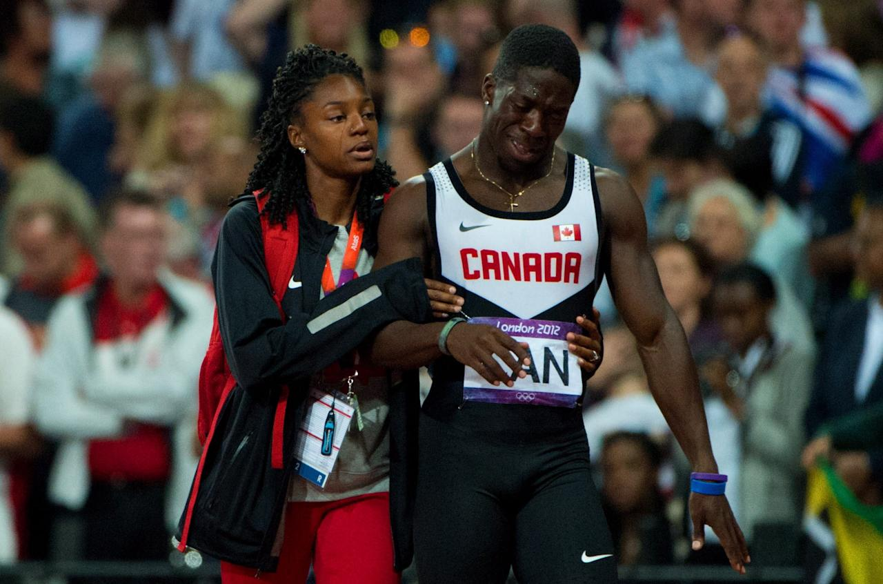 Canada's Justyn Warner reacts to being disqualified in the 4x100-metre relay at the 2012 Summer Olympics in London on Saturday, August 11, 2012. THE CANADIAN PRESS/Sean Kilpatrick