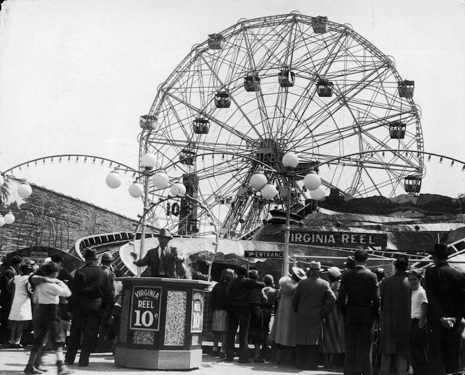 """<p>Coney Island's famed <a href=""""https://www.denoswonderwheel.com/"""" rel=""""nofollow noopener"""" target=""""_blank"""" data-ylk=""""slk:Wonder Wheel"""" class=""""link rapid-noclick-resp"""">Wonder Wheel</a> is celebrating its 100th anniversary in 2020. While it's not the oldest ferris wheel still in operation today — that's the <a href=""""https://www.wienerriesenrad.com/en"""" rel=""""nofollow noopener"""" target=""""_blank"""" data-ylk=""""slk:Weiner Riesenrad"""" class=""""link rapid-noclick-resp"""">Weiner Riesenrad</a> in Vienna, Austria — the Wonder Wheel distinguishes itself by having an inner ring of cars that roll back and forth as the wheel revolves. </p>"""