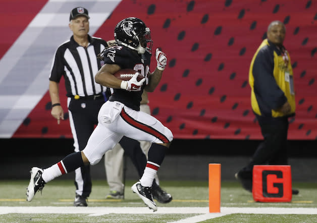 Devonta Freeman and his multidimensional scoring gets the ball rolling on Round 2. (AP)