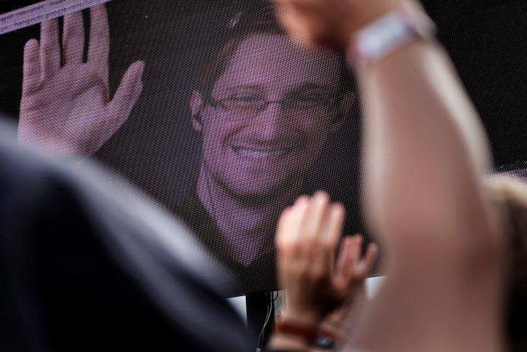 Revelers react as Edward Snowden is seen on a screen during the Roskilde Festival in Roskilde, Denmark, on June 28, 2016. (Photo: Scanpix Denmark/Mathias Loevgreen Bojesen /via Reuters)