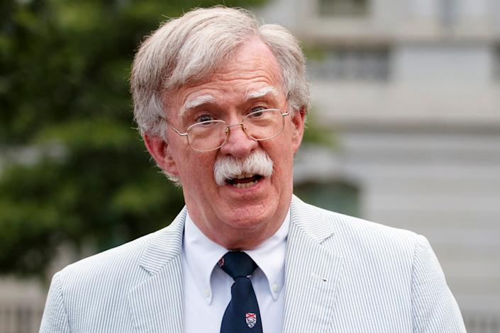 Then-national security adviser John Bolton speaks to media at the White House in Washington, July 31, 2019.