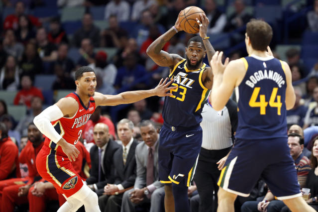 Utah Jazz forward Royce O'Neale (23) looks to pass the ball to forward Bojan Bogdanovic (44) while defended by New Orleans Pelicans guard Josh Hart (3) in the first half of an NBA basketball game in New Orleans, Monday, Jan. 6, 2020. (AP Photo/Tyler Kaufman)