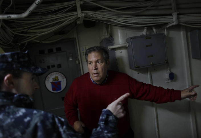 Bob Lewis tries to find his old quarters aboard the USS Enterprise during a tour of the ship Friday, Nov. 30, 2012, in Norfolk, Va. Lewis was an A-4 Skyhawk fighter pilot during the Vietnam War who flew 219 combat missions from The Big E. (AP Photo/The Virginian-Pilot, Stephen M. Katz) MAGS OUT