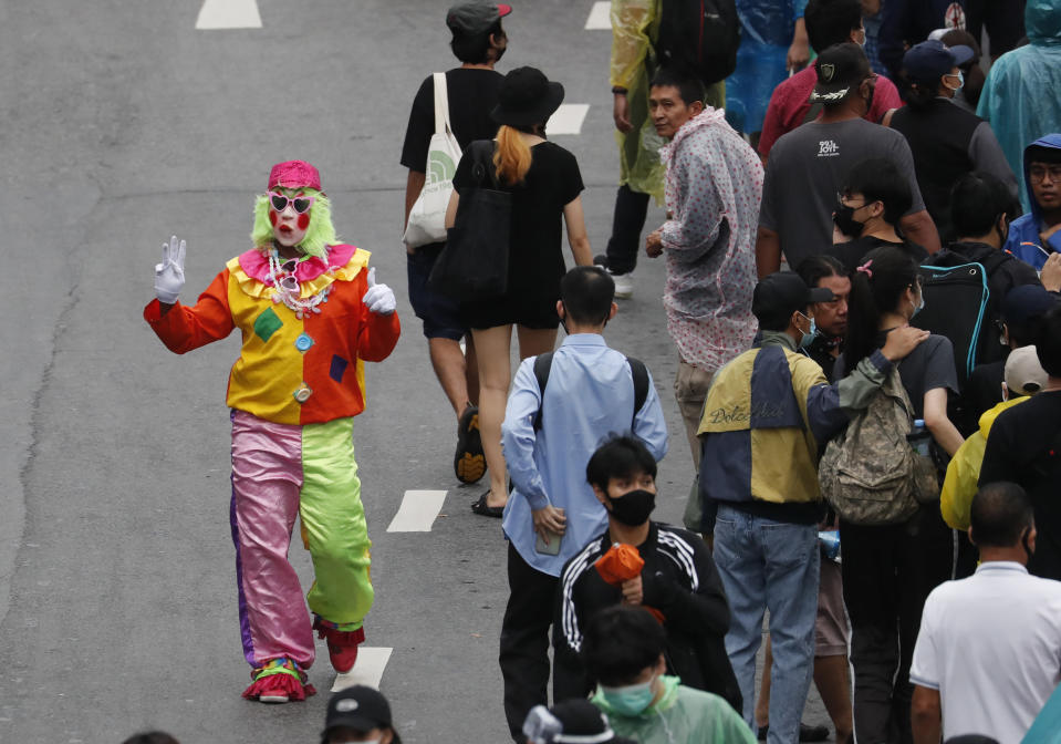A pro-democracy protester dresses as clown during a protest near a main train station in Bangkok, Thailand, Saturday, Oct. 17, 2020. The authorities in Bangkok shut down mass transit systems and set up roadblocks Saturday as Thailand's capital braced for a fourth straight day of determined anti-government protests. (AP Photo/Sakchai Lalit)