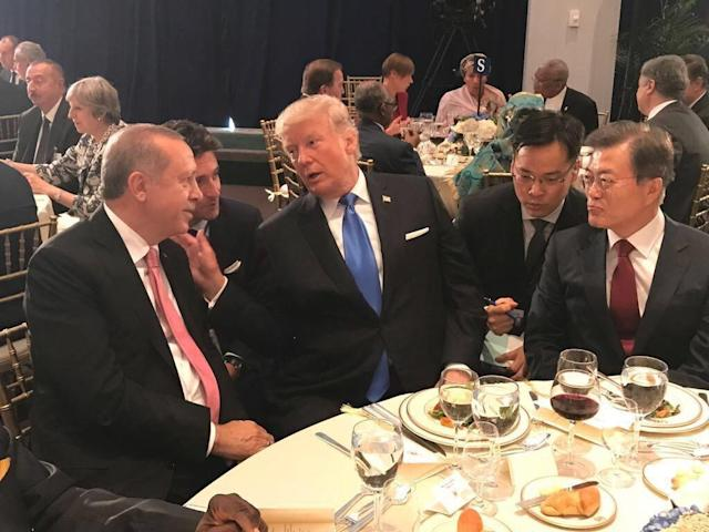 President of Turkey Recep Tayyip Erdogan (L) and US President Donald Trump (2 L) chat each other during a dinner hosted by United Nations Secretary General Antonio Guterres (not seen) within the 72nd session of the UN General Assembly in New York, United States on Sept. 19, 2017. (Photo: Turkish Presidency/Handout/Anadolu Agency/Getty Images)