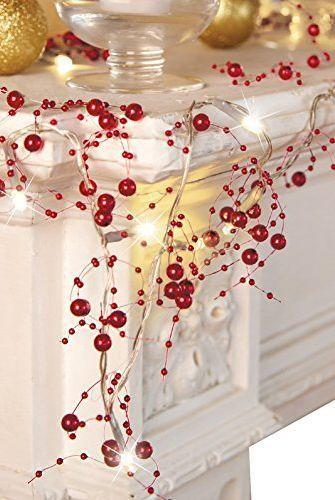 """<p>This delicate battery-operated garland can be added to greenery on the stairs (or anywhere else in your home!) to make it extra-special.</p><p><a class=""""link rapid-noclick-resp"""" href=""""https://www.amazon.com/dp/B07GKG2Y97?tag=syn-yahoo-20&ascsubtag=%5Bartid%7C2164.g.37723896%5Bsrc%7Cyahoo-us"""" rel=""""nofollow noopener"""" target=""""_blank"""" data-ylk=""""slk:SHOP BERRY GARLAND"""">SHOP BERRY GARLAND</a></p>"""