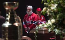 Mourners pay their respect to Montreal Canadiens legend Jean Beliveau during the public viewing for the Montreal Canadiens legend Jean Beliveau Sunday, Dec. 7, 2014, in Montreal. (AP Photo/The Canadian Press, Paul Chiasson)