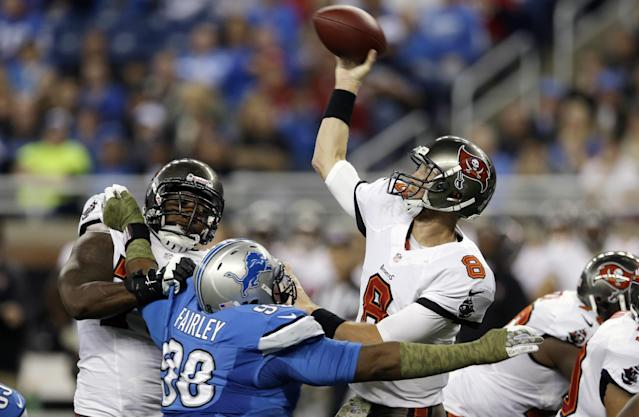 Detroit Lions defensive tackle Nick Fairley (98) pressures Tampa Bay Buccaneers quarterback Mike Glennon (8) during the first quarter of an NFL football game at Ford Field in Detroit, Sunday, Nov. 24, 2013. (AP Photo/Carlos Osorio)