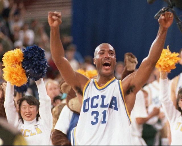 FILE - In this April 3, 1995 photo, UCLA's Ed O'Bannon celebrates after his team won the championship NCAA game against Arkansas in Seattle. O'Bannon is fond of his days at UCLA, and proud of his accomplishments. But even then he knew something wasn't right about a system that offered little more than room and board and books for his services. (AP Photo/Eric Draper, Draper)
