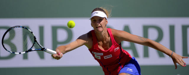 Karolina Pliskova, of the Czech Republic, returns a volley by Li Na, of China, during a third round match at the BNP Paribas Open tennis tournament, Monday, March 10, 2014 in Indian Wells, Calif. (AP Photo/Mark J. Terrill)
