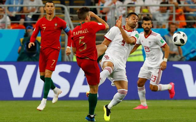 ​Spain vs Morocco, live updates 7:59PM Genius Iran have played really well but they were powerless to stop a moment of absolute genius from Quaresma, whose goal with the outside of his right boot separates the sides. As it stands Portugal are top of Group B and will play Russia in the last 16. Iran must score and hope Spain concede if they are to go through (or score twice themselves and render what happens in the Spain game irrelevant). Credit: REUTERS 7:48PM Half-time: Iran 0 Portugal 1 After being frustrated for most of the half, Portugal go in at half-time a goal to the good and - coupled with Spain drawing 1-1 with Morrocco - top of the group. 7:47PM 45+2 min Iran 0 Portugal 1 We're playing three minutes of added on time. 7:45PM GOAL! Iran 0 Portugal 1 (Quaresma 45 min) Oh my, that is absolutely sensational! Quaresma plays a one-two with Cedric and with the outside of his right boot bends a magnificent effort into the top corner from about 25 yards out. That is one of the goals of the tournament! 7:44PM 44 min Iran 0 Portugal 0 Ronaldo tries to win a corner down the Portugal left but ends up succeeding only in chesting the ball out of play. That rather sums up Portugal's half. 7:42PM 42 min Iran 0 Portugal 0 A bit more purpose from Portugal ends with Quaresma improvising an outside of the boot shot from about 10 yards out. The effort flies over the bar from a tight angle. Credit: REUTERS 7:40PM 40 min Iran 0 Portugal 0 Ronaldo tries his luck from about 35 yards. It's a decent effort but is slightly deflected and ends up straight down Beiranvand's throat. 7:38PM 39 min Iran 0 Portugal 0 Another Iran half-chance. They have a real threat on the counter but Amiri misplaces a pass meant for Omid just inside the box. 7:36PM 36 min Iran 0 Portugal 0 Iran have been brilliant and their supporters superb. But please: enough with the vuvuzelas. Credit: REUTERS 7:35PM 35 min Iran 0 Portugal 0 Jahanbakhsh delivers the free-kick, which Hosseini meets with a powerful near-post header that unfortunately for him is straight at Patricio. 7:34PM 34 min Iran 0 Portugal 0 Guerreiro, who was exposed in the first couple of games, is booked after scything down Jahanbakhsh. It came from another really pacy, purposeful Iranian break, and it's a free kick in a dangerous position out wide on the right. 7:30PM 31 min Iran 0 Portugal 0 A clash of heads at a Portugal corner sees Fonte and Sardar looking a little groggy. Thankfully both look ok to carry on. 7:29PM 29 min Iran 0 Portugal 0 More diligent work from Iran ends with the striker Sardar nipping in to win the ball back and then winning a free-kick off William Carvalho. Portugal look increasingly frustrated. 7:27PM 27 min Iran 0 Portugal 0 Iran are sitting very deep, and Portugal are struggling to find any space. Ronaldo tries to slip in Andre Silva but he's comfortably offside. Credit: Getty Images 7:24PM 25 min Iran 0 Portugal 0 Iran look dangerous again, but Amiri can't quite latch on to Omid's through ball. Amiri inadvertently catches Patricio as he goes for the ball, and the Portugal goalkeeper is down receiving treatment. He'll be fine. Iran vs Portugal shots on goal 7:22PM 22 min Iran 0 Portugal 0 It's a decent effort from Ramin but it flies a few feet wide of Patricio's goal. 7:21PM 21 min Iran 0 Portugal 0 Spain have equalised through Isco, so Spain now lead Group B. Meanwhile Adrien Silva gives away a free-kick in a dangerous area for pulling down Safi. Dangerous position for Iran. 7:19PM 19 min Iran 0 Portugal 0 Spain trailing Morocco 1-0 means Portugal are top of the group as it stands. 7:17PM 18 min Iran 0 Portugal 0 Adrien Silva wins a free-kick about 25 yards out, just to the right of the goal. Ronaldo fancies it but smashes his shot into the wall. He appeals for a handball but to no avail. Nothing in that. Credit: Getty Images 7:16PM 15 min Iran 0 Portugal 0 Portugal win a couple of corners and unsurprisingly stick them right under Beiranvand's crossbar. He deals with them a bit more comfortably. Meanwhile in Kaliningrad, Morocco have taken a shock lead against Spain. As it stands, Spain will still be going through but an Iran goal here would send them packing. 7:14PM 14 min Iran 0 Portugal 0 Iran's goalkeeper Beiranvand comes flapping out at Quaresma's cross and gets nowhere near it. Thankfully for him Hosseini is there to hack the ball away. Moments later, Beiranvand completely spills another Quaresma cross, but again his defenders mop up the danger. Horrible moments for Beiranvand. 7:11PM 11 min Iran 0 Portugal 0 What a mix-up that is! Beiranvand is absolutely furious after Ezatolahi seemingly ignores his goalkeeper's shout and clears Adrien Silva's cross straight to Joao Mario. Joao Mario should do better but blazes an effort over the bar from the edge of the area. Beiranvand shoves Ezatolahi in the chest in frustration. Lovely to see. Credit: AFP 7:08PM 8 min Iran 0 Portugal 0 Iran break really cleverly, but Amiri makes a mess of his shot from the edge of the box after arriving late and latching onto Mehdi's square pass. Decent opening for Iran, who up until then had barely gotten out of their half. 7:06PM 6 min Iran 0 Portugal 0 Andre Silva gets bundled to the ground by Ramin near the touchline but the referee waves play on. Iran very physical early on, as we expected them to be. 7:04PM 4 min Iran 0 Portugal 0 Early shot from Ronaldo. He bustles his way into the box and pings a shot off from about 12 yards out that Beiranvand does well to hold onto. 7:02PM 2 min Iran 0 Portugal 0 Guerreiro is chopped to the ground by Omid in what is a real 'welcome to the game challenge'. Iran clear the resulting free-kick. Huge noise from the Iran supporters. 7:00PM 1 min Iran 0 Portugal 0 We're under way in Saransk. Iran will qualify with a win; Portugal need just a point to go through, and to better Spain's result to top the group. The group winners play Russia in the last 16; the runners up will play Uruguay. A reminder of the teams for this one. Iran (4-3-2-1): Beiranvand; Ramin, Hosseini, Pouraliganji, Safi; Jahanbakhsh, Ezatolahi, Omid; Mehdi, Amiri; Sardar Portugal (4-4-2): Patricio; Cedric, Pepe, Fonte, Guerreiro; William Carvalho, Adrien, Joao Mario, Quaresma; Andre Silva, Ronaldo. Credit: Getty Images 6:57PM The teams are out It's a sell-out crowd at the Mordovia Arena, as the two sides belt out their respective national anthems. Iran look to have by far the majority of the fans inside the stadium. 6:52PM Those Portugal changes in full Now pay attention 007, because this is a little Silva-heavy. Andre Silva, Adrien Silva and Ricardo Quaresma come in, while Goncalo Guedes, Bernardo Silva and Joao Moutinho drop to the bench. Iran replace Karim Ansarifard with Alireza Jahanbakhsh. Bernardo Silva is on the Portugal bench Credit: Getty Images 6:43PM No Bernardo Silva is a suprise Ricardo Quaresma replaces him. Portugal remember are almost certainly out if they lose here. 6:37PM Prediction Who's going to win tonight? Let our clever machine tell you based on what you think the most important factors will be. World Cup 2018 Simulator Single Game 6:26PM Down to the wire There is the possibility that tonight could end in sensational fashion with the drawing of lots. That is if Portugal and Spain both win or draw with the exact same scoreline and end up with the same number of bookings (Spain as it stands have one fewer booking). The draw would take place at the Luzhniki Stadium in Moscow at 9pm BST this evening. It couldn't happen, could it? Spain take on Morocco in tonight's other game. 6:11PM Team news Iran (4-3-2-1): Beiranvand; Ramin, Hosseini, Pouraliganji, Safi; Jahanbakhsh, Ezatolahi, Omid; Mehdi, Amiri; Sardar Portugal (4-4-2): Patricio; Cedric, Pepe, Fonte, Guerreiro; William Carvalho, Adrien, João Mario, Quaresma; Andre Silva, Ronaldo. Three changes from the team that scraped to a 1-0 win over Morocco. #IRNPOR // The teams are in! pic.twitter.com/tmsdH1iunk— FIFA World Cup �� (@FIFAWorldCup) June 25, 2018 5:52PM What will Portugal's tactics be tonight? Our expert JJ Bull has taken a close eye at Fernando Santos's team, and brings you this video... 5:33PM How Group C looks going into the match Portugal need a draw to qualify for the last 16. 5:30PM The Ronaldo roadshow rolls on The final group games continue tonight, with Portugal in action against Iran. A draw will be enough for Portugal to qualify for the group stages, while Iran will qualify with a win. The picture is complicated by what Spain do against Morocco in the group's other match tonight, but essentially Portugal need to better Spain's result to top the group. There's a big incentive in topping the group because the winners will face Uruguay rather than Russia in the last 16. Earlier today Uruguay were very effective in brutally dismissing the hosts Russia 3-0 in Samara. Back to Group B and the matter in hand ... Portugal will be hoping not only to win but to produce a performance more convincing than the turgid fare they produced in Wednesday's 1-0 win over Morocco. Manager Fernando Santos is known for his pragmatic tactics, but even he accepted Portugal were disappointing in the way they sat back after taking an early lead. Cristiano Ronaldo was of course the man who scored their goal to add to his hat-trick against Spain on match day one. Ronaldo has scored all of Portugal's goals at this World Cup, and he will be desperate to get a couple tonight to leapfrog Harry Kane in the Golden Boot race. Ronaldo will also want to make a point to Iran manager Carlos Queiroz after the pair fell out at the 2010 World Cup when Queiroz was Portugal manager. Cristiano Ronaldo and Iran manager Carlos Queiroz do not see eye to eye Queiroz, for his part, will be focused on stopping Ronaldo tonight as his team look to build on their impressive - if ultra-defensive - performance against Spain last time out. Iran ended up losing 1-0 but were very close to nicking an unexpected point. Given their need for a win tonight, Iran will at some point need to come out and attack. Don't expect that to happen until the latter stages though, especially if Portugal fail to score early. Portugal should get this done, but they're going to have to work for it.