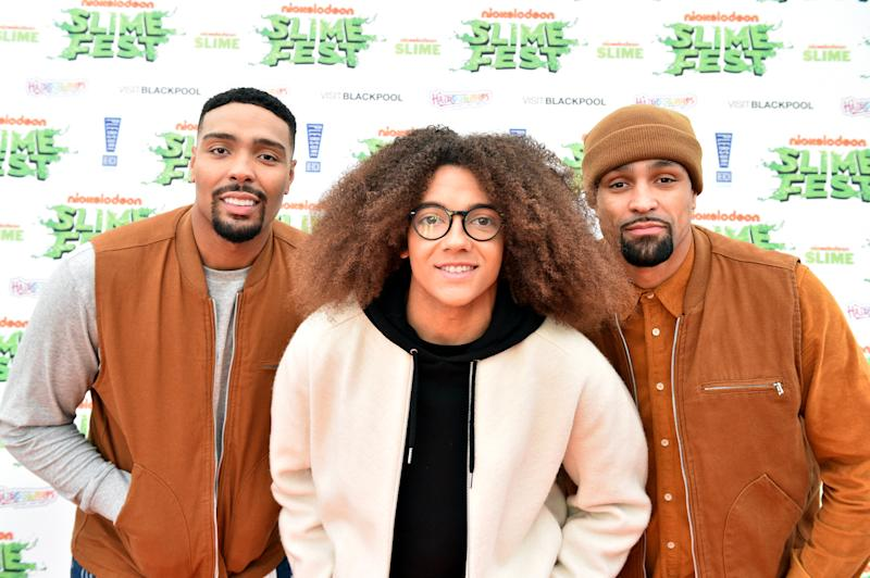 BLACKPOOL, ENGLAND - OCTOBER 19: (L-R) Jordan Banjo, Perri Kiely and Ashley Banjo of Diversity attend the Nickelodoen Slimefest at Blackpool Pleasure Beach on October 19, 2019 in Blackpool, England. (Photo by Shirlaine Forrest/Getty Images for Nickelodeon Slimefest)