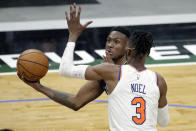 Milwaukee Bucks' Thanasis Antetokounmpo drives to the basket against New York Knicks' Nerlens Noel (3) during the second half of an NBA basketball game Saturday, March 27, 2021, in Milwaukee. (AP Photo/Aaron Gash)