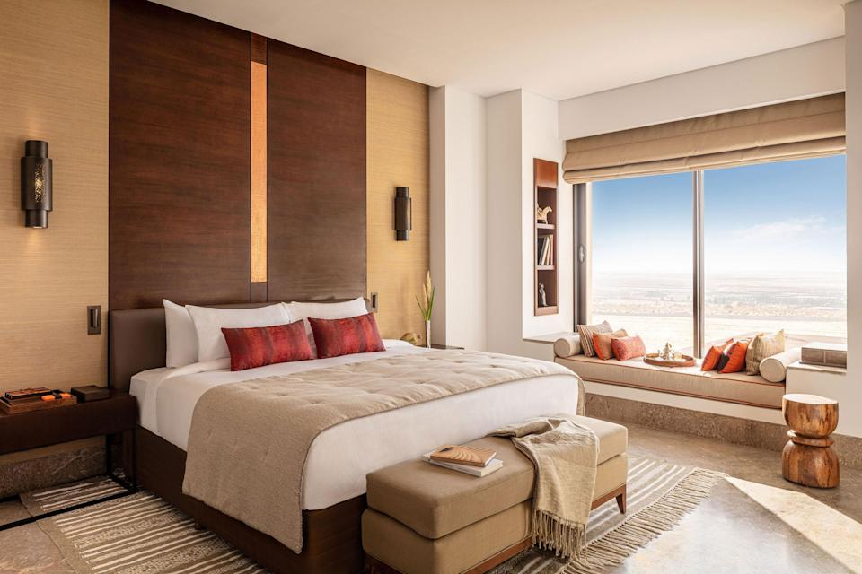 """<p><strong>Why did this hotel catch your attention? What's the vibe?</strong> The first thing I noticed was how hard it seemed to be trying <em>not</em> to attract attention: The earth-toned resort rises from the sands that surround it like, well, a mirage, and it took a moment as we were approaching for me to realize exactly where it was. It's the perfect setting for a desert hotel, seamlessly blending into its surrounds. That being said, I was surprised by the proximity—it's a five minute drive from the bustling town of Tozeur, but it feels like it's far removed. Once I got out of the car, exhausted after a seven-hour drive (there are quick flights from <a href=""""https://www.cntraveler.com/story/from-food-to-fashion-tunis-is-having-a-cultural-renaissance?mbid=synd_yahoo_rss"""" rel=""""nofollow noopener"""" target=""""_blank"""" data-ylk=""""slk:Tunis"""" class=""""link rapid-noclick-resp"""">Tunis</a> to an airport 15 minutes away that most guests would use, I just wanted to see more of the country so I requested a car transfer), the grand lobby, with a soaring ceiling, marble floors and pillars, a water feature, and soothing neutral tones, was immediately calming. When you cross through the lobby to the back where a golf cart awaits to take you to your room, you get a great view of the hotel grounds—it looks like a little oasis of its own, with palm trees, swimming pools, and a village of standalone suites.</p> <p><strong>What's the backstory?</strong> It's part of the global Anantara brand, known for luxurious spa-focused resorts all over the world, often in remote, stunning settings like this one. It's the brand's first hotel in Tunisia and one of the biggest luxury openings the country has ever seen, following the 2017 opening of the <a href=""""https://www.cntraveler.com/hotels/tunis/four-seasons-hotel-tunis?mbid=synd_yahoo_rss"""" rel=""""nofollow noopener"""" target=""""_blank"""" data-ylk=""""slk:Four Seasons Tunis"""" class=""""link rapid-noclick-resp"""">Four Seasons Tunis</a>. In the days I was in Tunis leadi"""