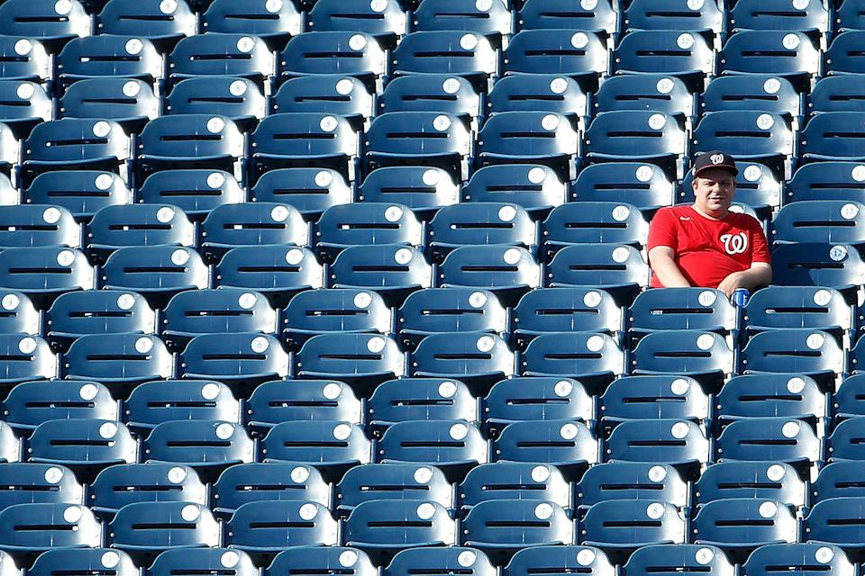 A Nationals fan looks on during a September game in Washington.