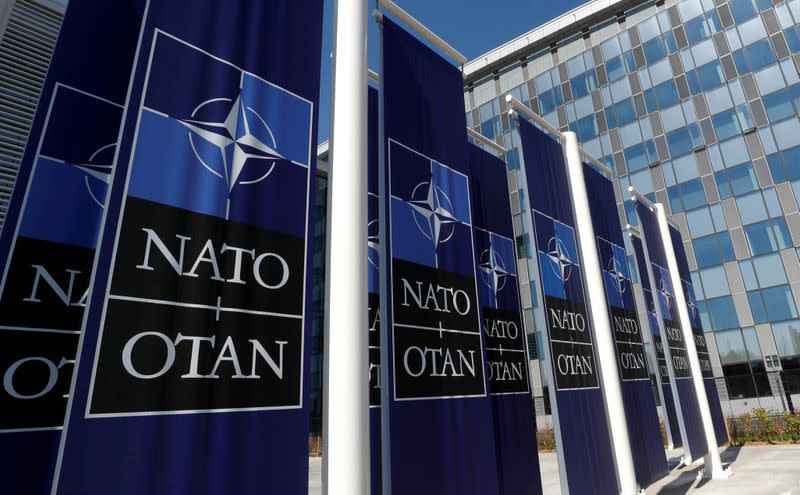 FILE PHOTO: Banners displaying the NATO logo are placed at the entrance of new NATO headquarters during the move to the new building