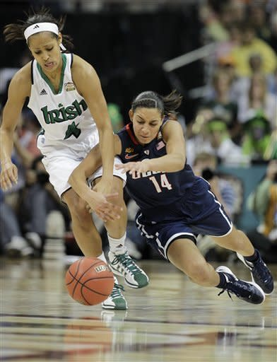 Notre Dame guard Skylar Diggins (4) and Connecticut guard Bria Hartley (14) vie for a loose ball during the second half of the NCAA women's Final Four semifinal college basketball game, in Denver, Sunday, April 1, 2012. (AP Photo/Julie Jacobson)
