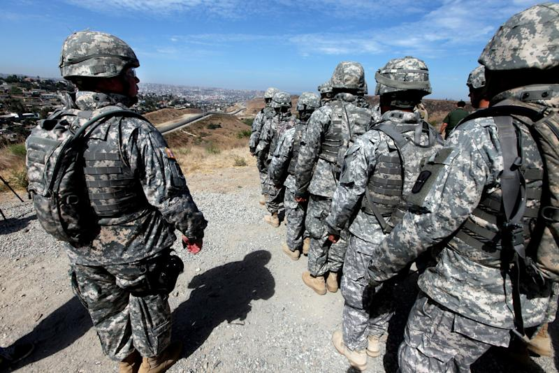 File photo shows National Guard troops standing in formation along the US-Mexico border in San Ysidro, California during a visit by California Gov. Arnold Schwarzenegger on August 18, 2010 (AFP Photo/Sandy Huffaker)