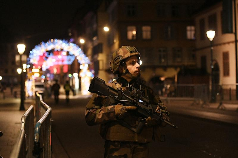 A soldier patrolling near the famed Christmas market in Strasbourg, which has become the latest French city to be hit by a suspected deadly terror attack