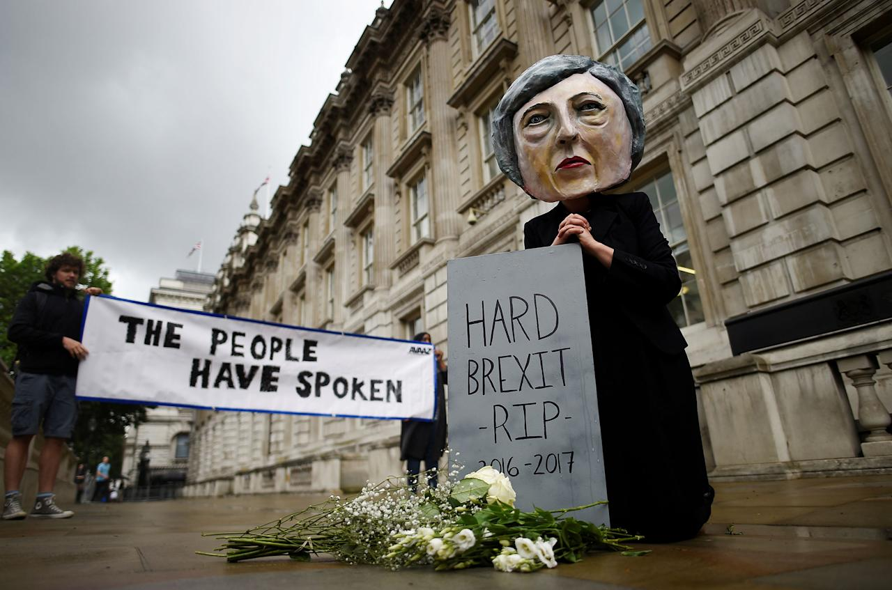 <p>Protestor wearing a Theresa May mask is seen the day after Britain's election in London, Britain June 9, 2017. (Photo: Clodagh Kilcoyne/Reuters) </p>
