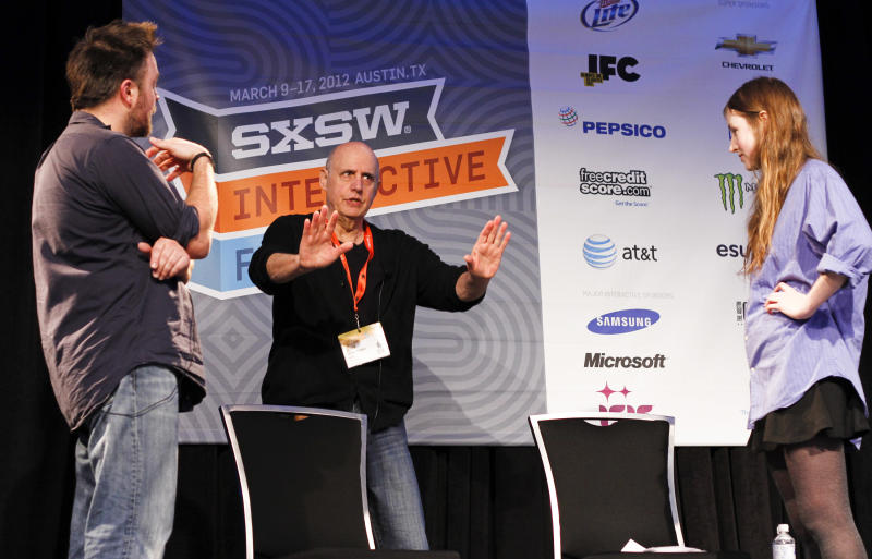 Jeffrey Tambor, center, conducts his acting workshop with students Matthew Newton, left, and Kate Sheil during the SXSW Film Festival and Conference in Austin, Texas, on Sunday, March 11, 2012. (AP Photo/Jack Plunkett)