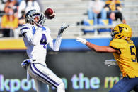 Kansas State wide receiver Malik Knowles (4) makes a catch for a touchdown against West Virginia during an NCAA college football game Saturday, Oct. 31, 2020, in Morgantown, W.Va. (William Wotring/The Dominion-Post via AP)