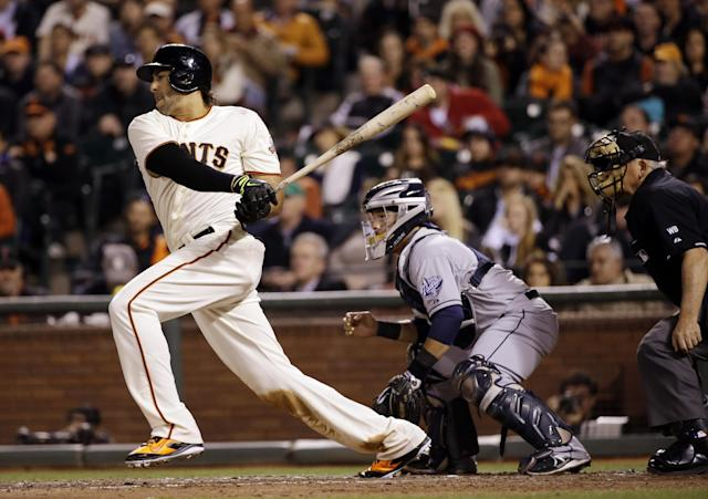 San Francisco Giants' Michael Morse follows through on a two-run single against the San Diego Padres during the fourth inning of a baseball game Monday, April 28, 2014, in San Francisco. (AP Photo/Marcio Jose Sanchez)